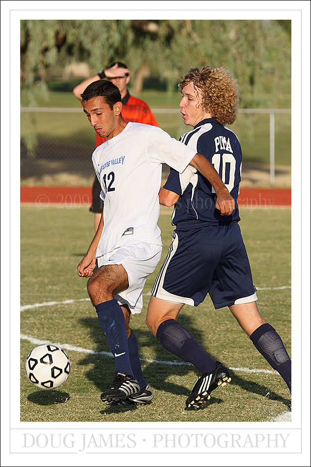 PHOENIX, AZ – OCTOBER 7, 2009: Andranik Hakaboyan (12) of the PVCC Pumas fights for control of the ball with Jann Nash (10) of the Pima Aztecs.