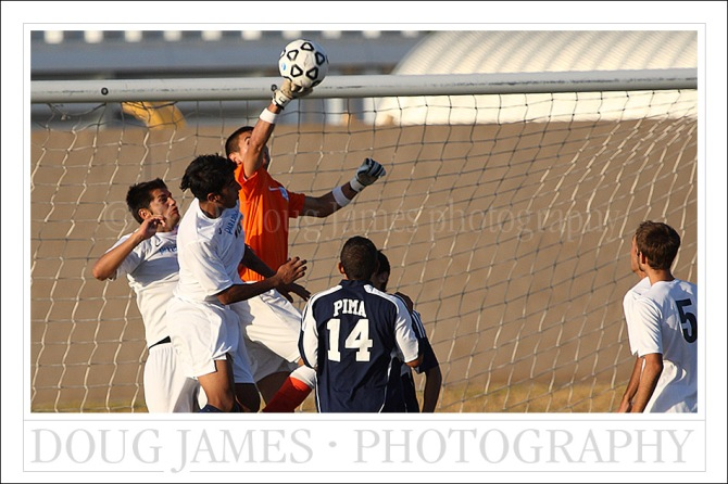 PHOENIX, AZ – OCTOBER 7, 2009: The goalkeeper for the Pima Aztecs stops a late match goal attempt by the PVCC Pumas.